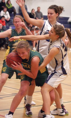 Kaylee Zoeteman and Carlee Prete of the F.P. Walshe Flyers fight for the ball in the final against Coaldale Christian Titans.