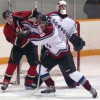 Justin Van Herk of the Fort Macleod Mustangs battles Byron Jackson of the Peigan Cowboys.