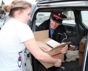 Kyraya Sutherland helps Maj. Brian Beveridge