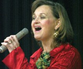 Laura Martin led the carolling Sunday during the 46th Rotary Carol Festival.