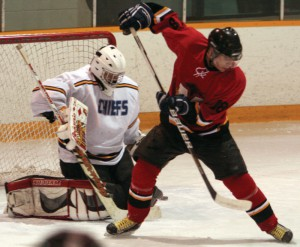 Fort Macleod Mustangs forward Tyce Gallamore deflects a shot just wide of Kainai Chiefs goalie Jace Scout.