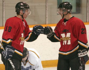 Tyce Gallamore and Cole Matson of the Fort Macleod Mustangs celebrate a goal Friday night against Kainai Chiefs.