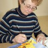 Heather Dodd works on a watercolour painting Feb. 12 at the Scout Hall.
