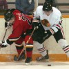 Tanner Benns of the Fort Macleod Mustangs battles along the boards with Brendyn Lanz of the Brooks Black Hawks.