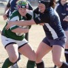 Amanda Hofer of the F.P. Walshe Flyers (right) battles a Medicine Hat Kwahommie for possession of the ball on Wednesday.