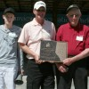 Bailey Poelman, Travis Poelman, Leroy Poelman and Ralph Poelman accept the Alberta Century Farm and Ranch Award from Livingstone-Macleod MLA Evan Berger.