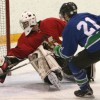 Fort Macleod Mustangs goalie Cody Hall stops Tofield Satellites Doug Woiken on this scoring chance.