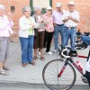 Rev. Eras Van Zyl cycles down Main Street on Friday followed by the Fort Macleod Handibus.