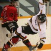 Call Marr of the Fort Macleod Mustangs collides with Russell Wells of the Kainai Chiefs.