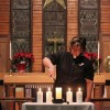 Rev. Pilar Gateman lights the candle of Remembrance. After the performance of the Liturgy of Remembrance candles were lit at an open memorial service