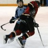 Call Marr of the Fort Macleod Mustangs steps into a Lomond Lakers player during Friday night's game.