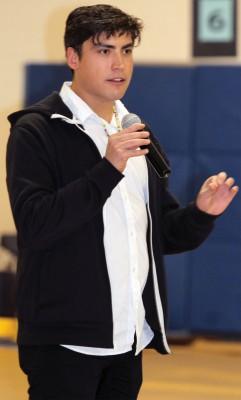 Actor Colin Van Loon speaks at school