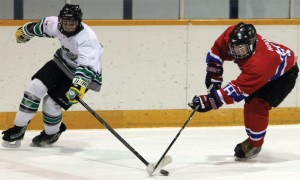 Colten Holtz of the Fort Macleod Mavericks (right) steals the puck from a Claresholm Thunder player