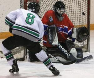 Ryan Rice (8) of the Claresholm Thunder aims for an open corner against Fort Macleod Mavericks goalie Donovan Flobert.