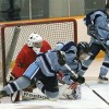 Fort Macleod Mustangs goalie Cody Hall sprawls to make a save off a falling Lomond Lakers player