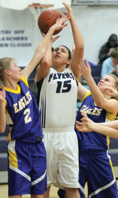 Jayden Goodstriker (15) of the F.P. Walshe Flyers puts up a shot against Immanuel Christian Eagles.