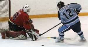 Fort Macleod Mustangs goalie Cody Hall finds himself one-on-one with Lomond Lakers Mike White Quills.