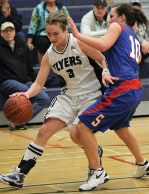 Sam Bassett of the F.P. Walshe Flyers (3) drives past Jessie Roan of Stirling in the tournament championship game.