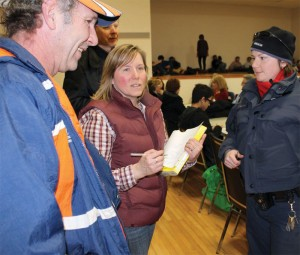 Fort Macleod Mayor Shawn Patience and FCSSdirector Angie O'Connor get an update on the highways Sunday evening from RCMP Const. Chantel Robitaille.