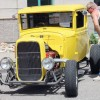 Vintage and custom automobiles line Fort Macleod's historic Main Street in April during Spring Breakout