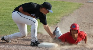 TJ Tornquist tries to pick off a Medicine Hat Knight at first base.
