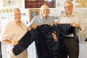 Jack Altman presented his old White Sox jacket to the Granum Old Jail and Museum on Aug. 4. From left: John Connor of the museum board; Altman; and Mike Sherman of the museum board.