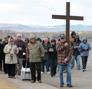 The foothills provided a scenic background for the Way of the Cross procession as Joe Hamacher carries the wooden cross.
