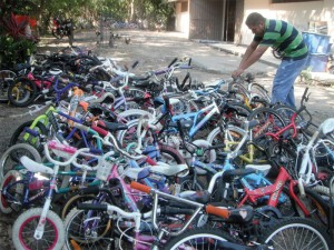 Ulises Rivera Romero unloads some of the 594 bikes that Bicycles For Humanity delivered in April to Zihuatanejo, Mexico.