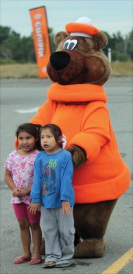 Fancy and Marius Buffalo with the A&W mascot, the Great Root Bear.