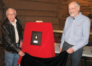 Fort Macleod resident John Viens and archeologist Jack Brink unveiled the framed atlatl dart Saturday at Head-Smashed-In Buffalo Jump.