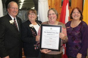 Former Lions Clubs International director Dave Hajny, Lions District Governor Pauleen Cooper, Fort Macleod Lions Club president Diane Ball and secretary Michelle Harris.