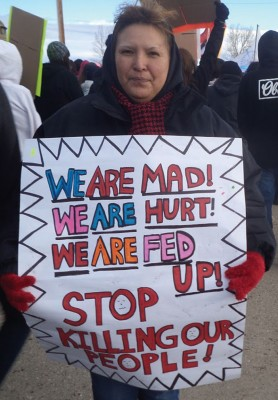 Members of the Blood Tribe marched from Moccasin Flats to the Moses Lake Community Center.