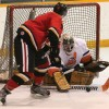 Mustangs forward Cody Berbue can't get the puck past Kainai goalie Danny Weasel Fat.