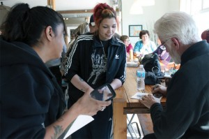Ted Danson signs autographs