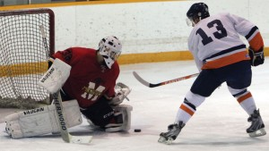 Mustangs goalie Joel Pozzo turns away Kainai's Jeremy Weasel Moccasin.