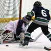 Mavericks goalie Mason Brussee turns aside this Claresholm scoring attempt.