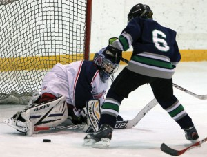 Mavericks goalie Mason Brussee turns aside this Claresholm scoring attempt.