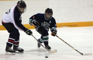 Shooter Goodstriker of the Mavericks carries the puck against the Claresholm Thunder.