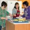 Melody Bannerman, Val Kostelansky and Stasha Donahue prepare to serve lunch as part of the Justice Film Festival.
