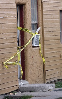 Forensic team members enter the motel room in Fort Macleod where an unresponsive man was found.