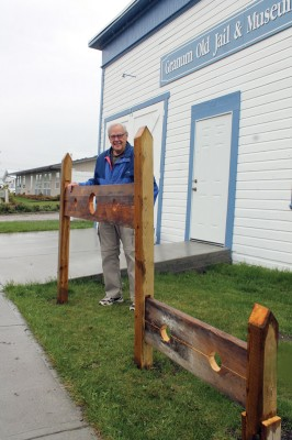 Granum Old Jail and Museum volunteer Mike Sherman beside the new pillory and stock built by Gavin Moore for the Granum Old Jail and Museum.