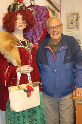Granum Old Jail and Museum volunteer Mike Sherman poses with the display on Rainbow Power, a character from Granum's colorful past.