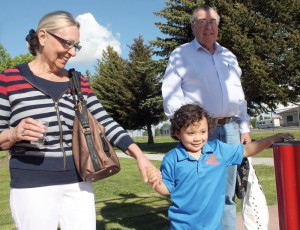 Matthew McNab, accompanied by grandparents Bernadette and Dave McNab, pressed the button to start the water at the spray park.d