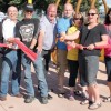 Cutting the ribbon to open the spray park, from left: Sharon Monical, Keith Trowbridge, Dan Smith, Henk Vanee, Dan Smith, Angie O'Connor, Jill Burrows and Leslie-Ann Hornberger.