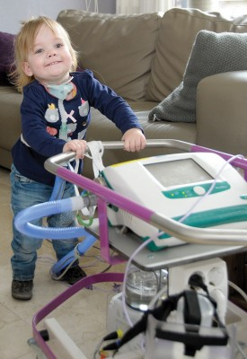 Surgery will cost $110,000 for Elin Valk, shown here with the machine that helps her breathe.