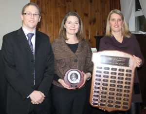 Ronda Reach accepted the Citizen of the Year Award from Brian Nelson and Domiec Holwerda.