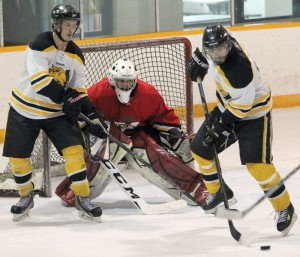 Fort Macleod goalie Cody Hall watches as the puck blasts through traffic in front of his crease provided by Nanton's Dillon Loomer (left) and Brady Egger.