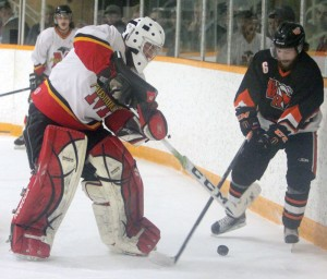 Cody Hall battles with Wainwright's Trevor Klasson behind the Fort Macleod goal.