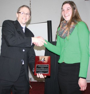 Brian Nelson presented the Community Enhancement Award to Emilene Koptelaar from Hansen Family Foods.