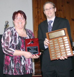 Michelle Harris of Fort Pharmacy accepted the Customer Service Award from Brian Nelson.